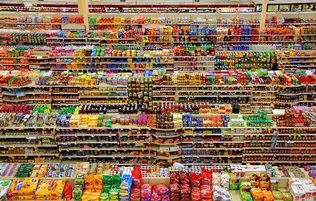 colourful supermarket shelves are covered in packages