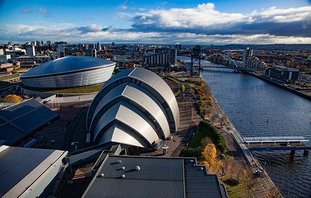 COP26 Glasgow as seen from the sky, looking down over a river and the Scottish Events Campus
